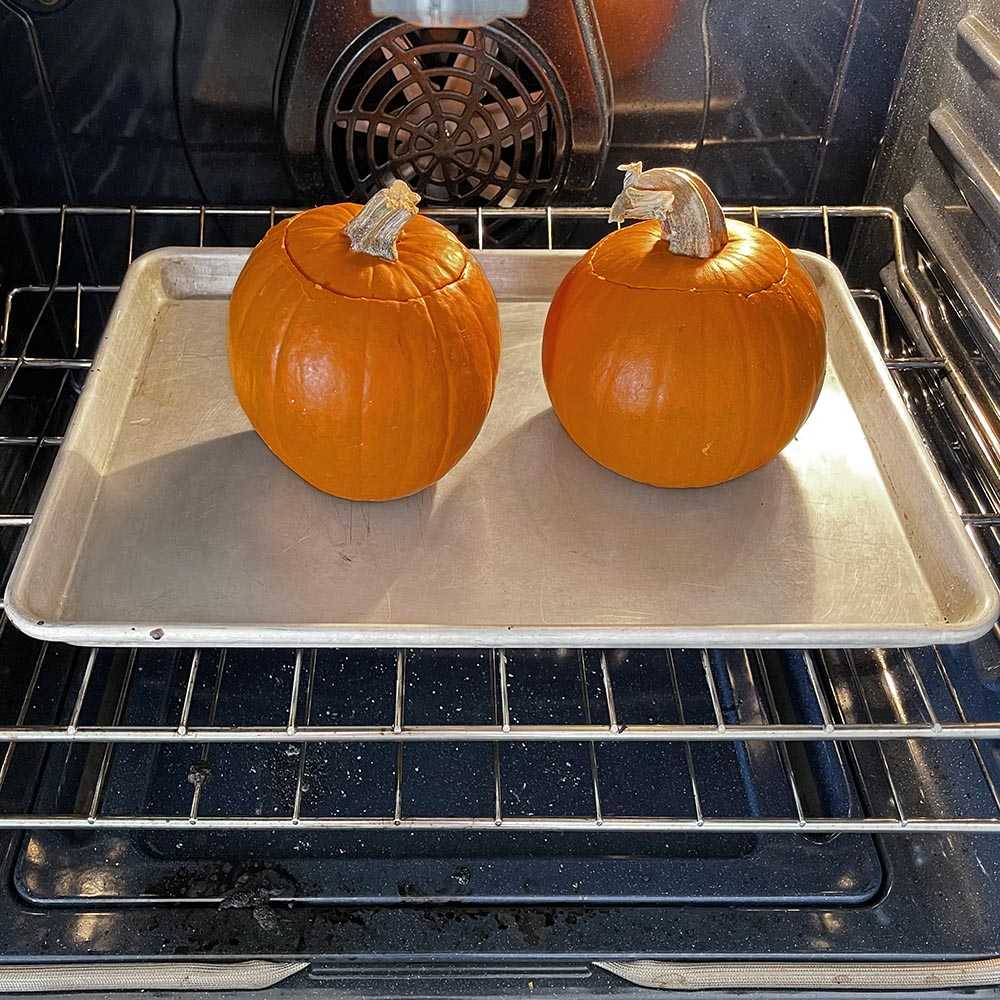 Two pumpkins stuffed and in the oven