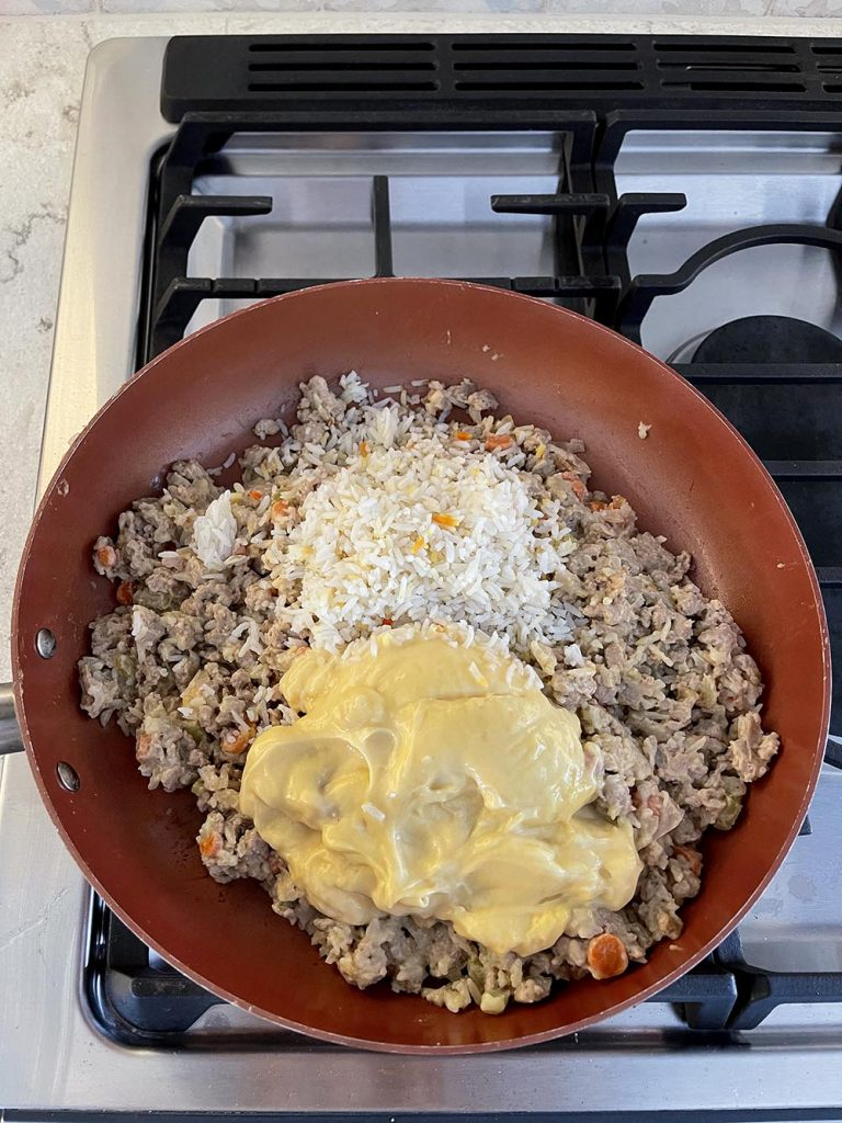 Ground turkey, rice, and soup mix in skillet for filling